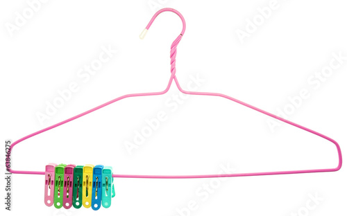Colorful clothes Pegs clamped to pink hanger isolated