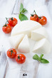 Sliced adygea cheese, baked tomatoes and mint