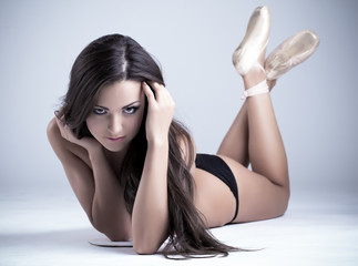sexy girl with long hairs lay in ballet pointes