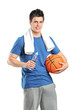 Male athlete holding bottle od water and a basketball