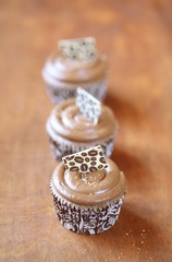 Coffee Cupcakes on a wooden table.