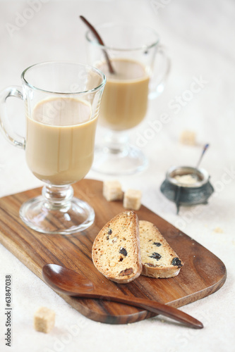 Cardamom Raisin Biscotti with two cups of coffee