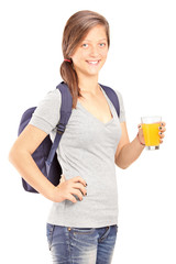 Schoolgirl holding a glass of orange juice