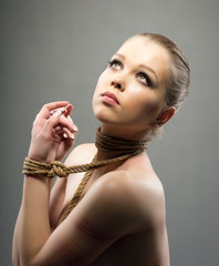 Nude young woman with shibari