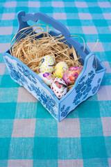 easter eggs in blue basket