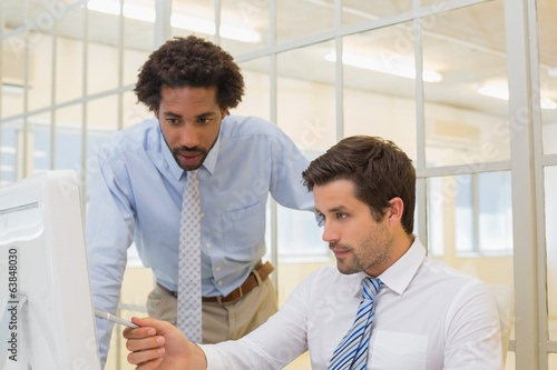 Businessmen working on computer in office