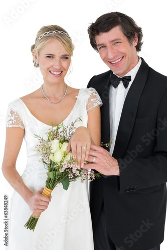 Happy bride and groom showing wedding rings