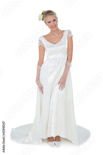 Beautiful bride standing over white background