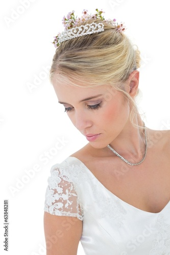 Shy bride looking down over white background