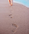Women's footprints in the sand