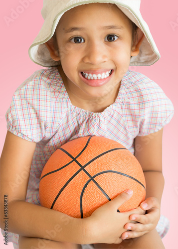 little cute girl with basketball