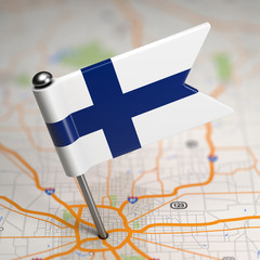 Finland Small Flag on a Map Background.