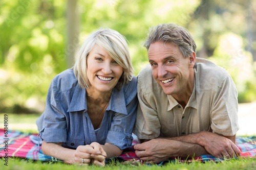 Couple lying on blanket in park