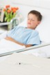 Syringe on table with boy in hospital ward