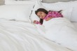 Young girl sleeping in bed at home