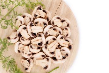 Sliced mushrooms on platter.