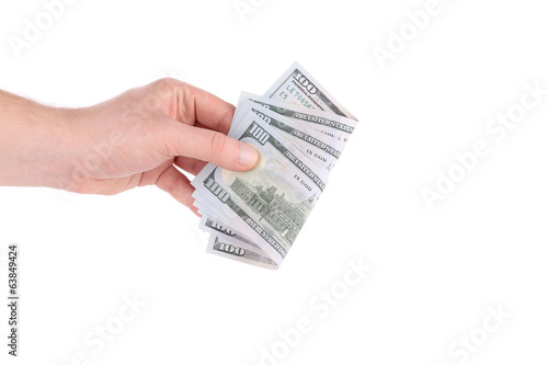 Hand holds dollar bills.