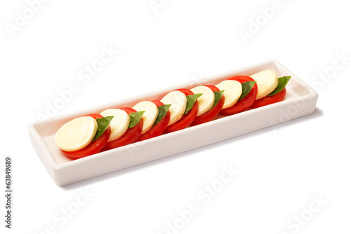 Caprese on a white rectangular plate