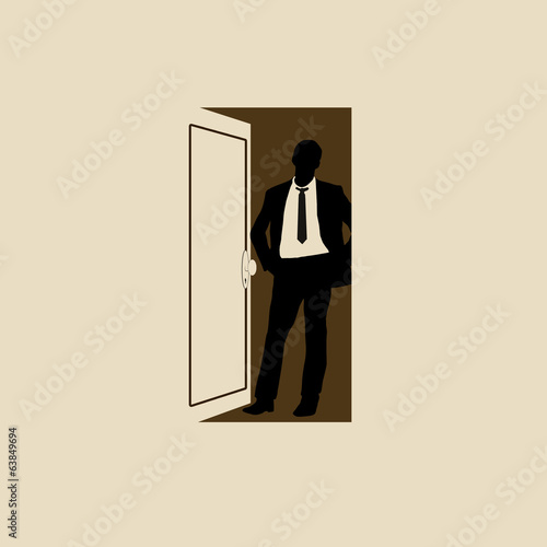 Businessman in doorway