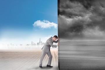 Composite image of businessman pushing away scene