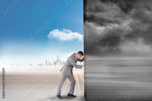 Composite image of businessman pushing away scene