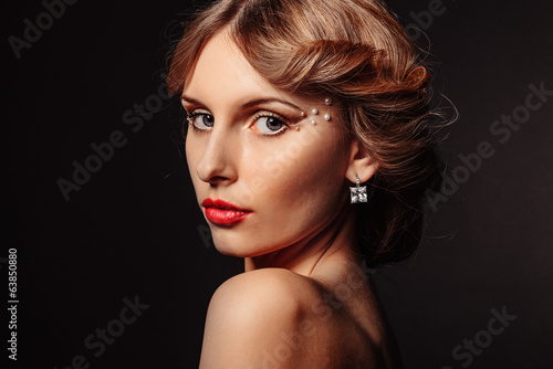 Beauty portrait of beautiful blond girl on black background