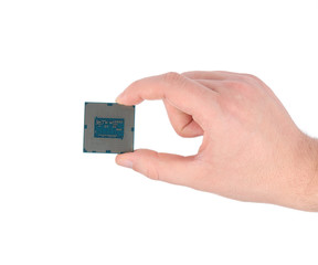 Hand holding a computer CPU chip.