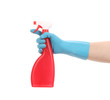 Hand in glove holding red plastic spray bottle.