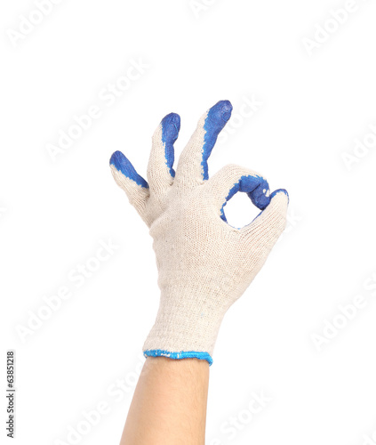 Hand in protective glove shows sign ok.