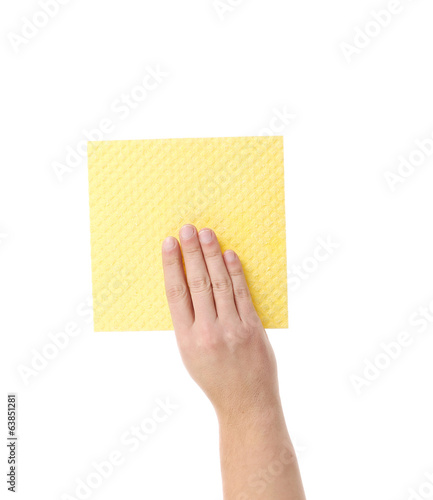 Hand holds yellow cleaning sponge.