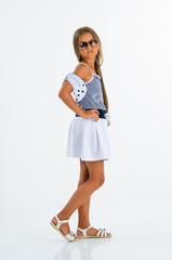 beautiful tanned girl in bright summer sundress in the studio