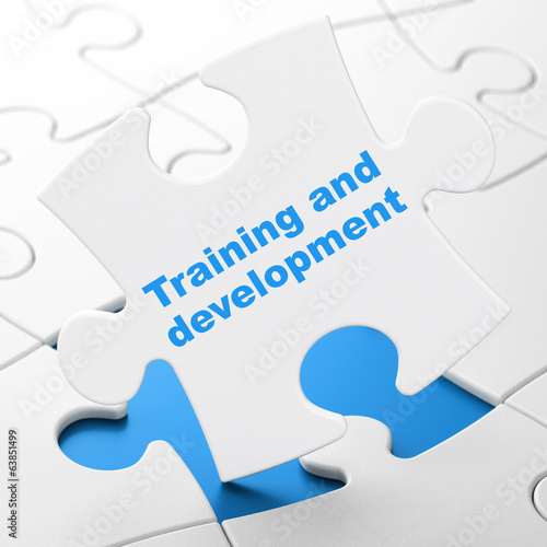 Education concept: Training and Development on puzzle background
