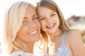 happy mother and child girl outdoors