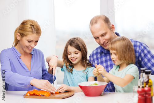 happy family with two kids making dinner at home