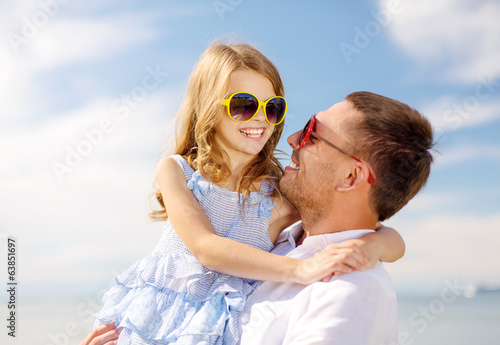 happy father and child girl having fun outdoors