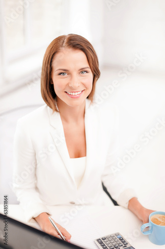 businesswoman with computer, documents and coffee