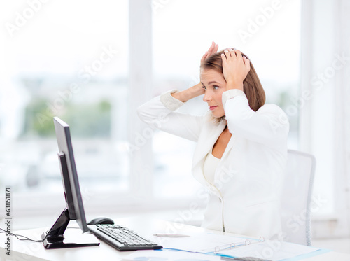 stressed businesswoman with computer at work