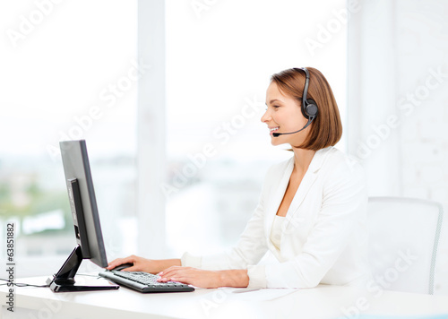 friendly female helpline operator with computer
