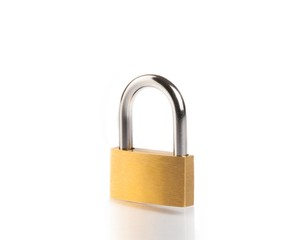 metal padlock with reflection on white table
