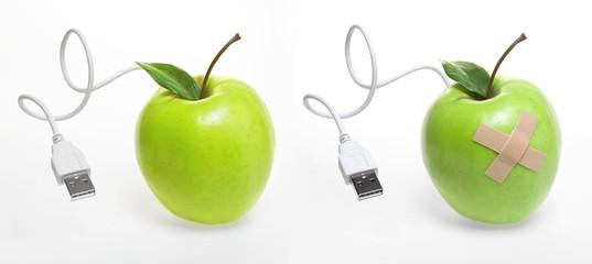 Zwei grüne Äpfel mit Usb-kabel