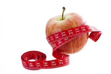 Roter Apfel mit Massband
