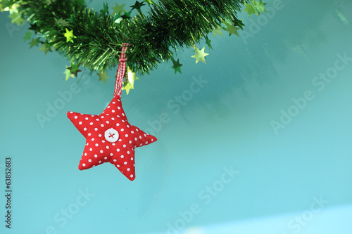 Red star fabric hanging on glass background