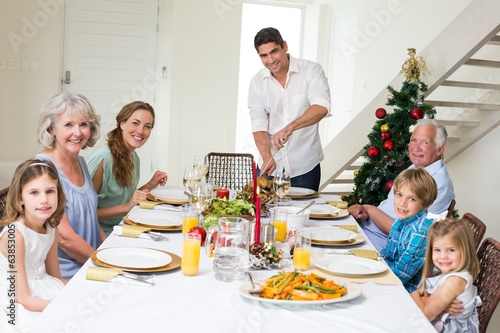 Family having Christmas meal at dining table