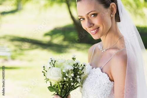 Closeup of bride with bouquet in garden
