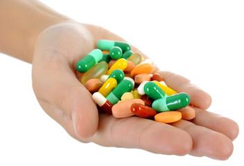 Hand voller Pillen, Tabletten und Medikamente