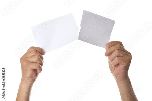 Hands tearing paper sheet