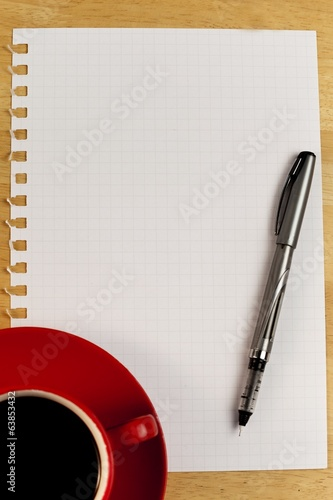 Overhead of graph paper coffee and pen