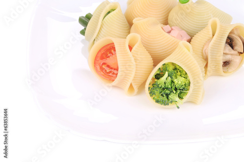 Stuffed pasta shells with broccoli and mushrooms.