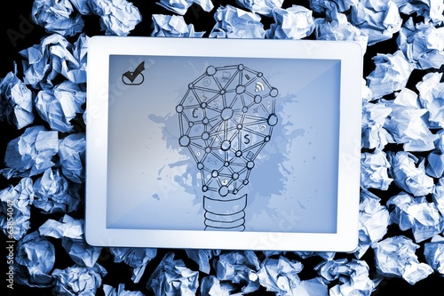 Composite image of light bulb on paint splashes