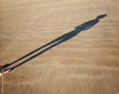 woman shadow in the beach